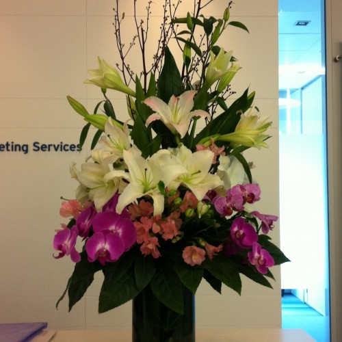 Lily with orchids $680